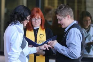 Stacey Maloney, right, places a ring on the finger of Tina Johnson, left, as Reverend Audette Fulbright looks on while getting married outside the Laramie County Courthouse in Cheyenne, Wyoming on October 21, 2014. Johnson and Maloney became one of the first same sex marriages in Wyoming. Michael Smith/staff